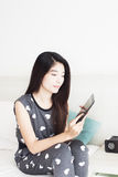 Young woman playing games on tablet Stock Images
