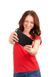 Young woman playing games on tablet Royalty Free Stock Image