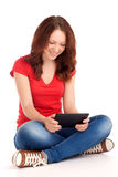 Young woman playing games on tablet Royalty Free Stock Photos
