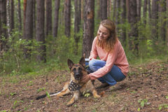 Young woman playing with German shepherd Royalty Free Stock Photos