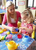 Young woman playing with girl Stock Image