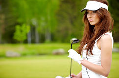 Young woman playing golf Stock Image