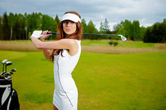 Young woman playing golf Stock Photo