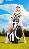 Young woman playing golf royalty free stock photography