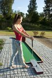 Young woman playing golf in a country club Stock Photo