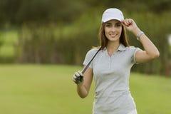 Young woman playing golf Stock Photos
