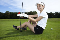 Young woman playing golf Royalty Free Stock Photo