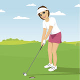 Young woman playing golf preparing to shot putting on green course Stock Photography