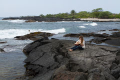 Young Woman Playing Guitar by the ocean in Hawaii Stock Photography