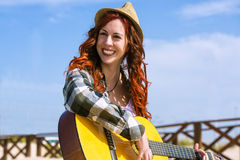 Young woman playing a guitar Royalty Free Stock Photography