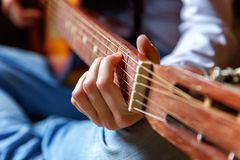 Young woman playing guitar Royalty Free Stock Photo