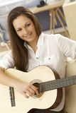 Young woman playing the guitar Royalty Free Stock Photography