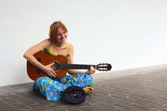 Young Woman Playing the Guitar on the Street Stock Photos