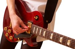 Young woman playing the guitar on white stock photography