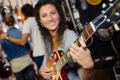 Young woman playing guitar Royalty Free Stock Photography