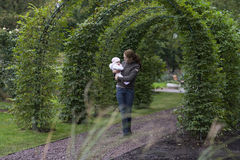 Young woman playing with her baby in a park Royalty Free Stock Photo