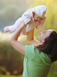 Young woman playing with her baby Royalty Free Stock Image