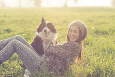 Young woman playing with her border collie dog Royalty Free Stock Images