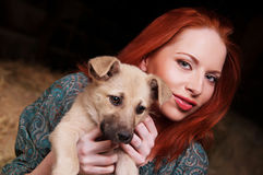 Young woman playing with her dog Stock Photos