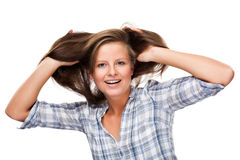 Young woman playing with her hair Royalty Free Stock Images