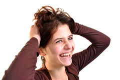 young woman is playing with her long hair Royalty Free Stock Images