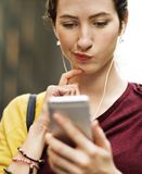 Young woman playing on her phone stock images