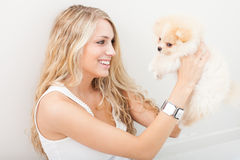 Young woman playing with her tinny dog Royalty Free Stock Photo