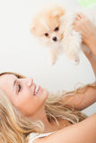 Young woman playing with her tinny dog Stock Photos