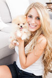 Young woman playing with her tinny dog Stock Photography