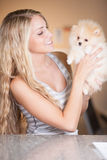 Young woman playing with her tinny dog Stock Image