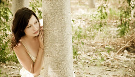 Young woman playing hide and seek Royalty Free Stock Images
