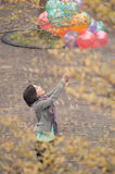 Young woman playing and holding balloons Royalty Free Stock Images