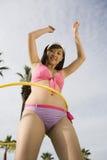 Young Woman Playing Hula Hoop Royalty Free Stock Photos