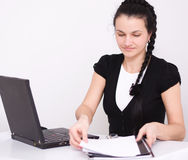 Young woman is playing on laptop Royalty Free Stock Photo