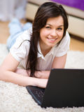Young woman is playing on laptop. Indoor shoot Stock Photos