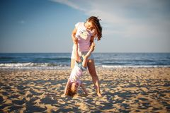Young woman playing with little girl royalty free stock images