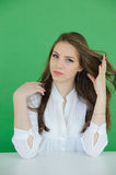 Young woman playing with long, brown hair  Stock Images