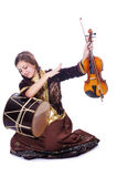 Young woman playing musical instruments. On white Stock Photo