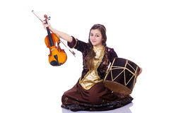 Young woman playing musical instruments Royalty Free Stock Images