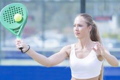 Young woman playing paddle match Stock Photo