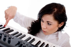 Young woman playing piano Royalty Free Stock Images