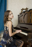 The young woman is playing piano