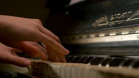 A young woman playing piano closeup. Piano hands pianist playing Musical instruments details with player hand closeup Stock Image