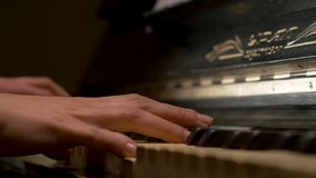 A young woman playing piano closeup. Piano hands pianist playing Musical instruments details with player hand closeup Stock Images