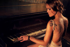 Young woman playing piano Royalty Free Stock Photos