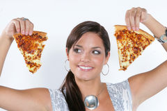 Young woman playing with pizza Royalty Free Stock Images