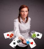 Young woman playing with poker cards and chips Stock Image