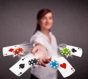 Young woman playing with poker cards and chips Stock Images