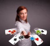 Young woman playing with poker cards and chips Royalty Free Stock Image