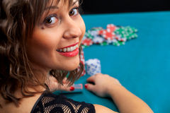 Young woman playing poker Stock Photo